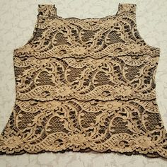 "Gold & black lace tank Lovely lace tank to wear with a suit or  just about anything.  Dress up or down. Measures  approx  17"" pit to pit x 19 1/2"" length x 15"" waist.  Does not say what size. Tops Tank Tops"