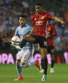 Marcus Rashford of Manchester United in action with Gustavo Cabral of Celta Vigo during the UEFA Europa League semifinal first leg match between...