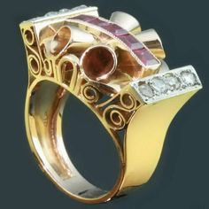 pink gold retro ring with rose cut diamonds and carre cut rubies