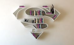22 Creative Bookshelves Guaranteed to Give You Shelf Envy Who doesn't love superman decor? These creative floating bookshelves are definitely super. Creative Bookshelves, Floating Bookshelves, Bookshelf Ideas, Bookshelf Design, Wall Shelves, Shelving, Book Shelves, White Shelves, Diy Furniture
