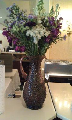 antique vase with wildflowers