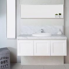 The London. Matte white, Carrera top with the Dignity semi-inset basin. #bathroom #london #interior #white #grey #marble