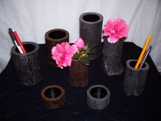 Tree trunk vases and pen holders