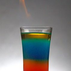 If you like living life on the wild side, you'll love this shot! The Flaming Rainbow Shot is beautifully made with cool differently colored layers, and finally a flame tops it all off!It's really rather easy to make this shot at home with just a few Flaming Cocktails, Flaming Shots, Rainbow Shots, Rainbow Drinks, Rainbow Cocktail, Layered Drinks, Fun Shots, Shots Drinks, Jello Shots
