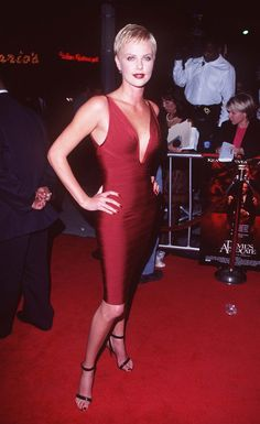 Pin for Later: How Charlize Theron Has Schooled Us All in Sexiness  Charlize hit the October 1997 premiere of Devil's Advocate in a bandage-style red dress.