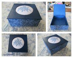 """Inspiration Cartonnage -> la Boite bleue sur le blog de """"La Césarée """". Boite avec un couvercle monté sur charnière selon un patron maison (taille 12cmx12cm x5cm) - Motif broderie du blog Luli brodé sur toile aïda 7pts/cm - Fils DMC - Papier Simili Cuir (Skivertex/Nitrolin) et papier artisanal uni provenant de la boutique l'Éclat de Verre http://shop.eclatdeverre.com/Papiers-C7"""