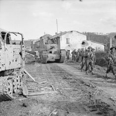 A Churchill tank and British infantry advance after crossing the River Savio, Italy, 24 October 1944. - See more at: http://ww2today.com/#sthash.5Dncfpu0.dpuf
