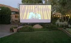 This may be one of our most fun summer garden fun ideas yet! Build a backyard movie theater! Ok, it wasn't our idea. But we're running with it. Sound like an impossible DIY project? Outdoor Projector Screen Diy, Outdoor Movie Screen, Outdoor Theater, Backyard Movie Theaters, Backyard Movie Nights, Outdoor Movie Nights, Doors Movie, Backyard Patio, Backyard Ideas