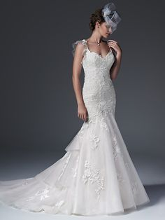 Sottero and Midgley - ELIZABETH, Chic fit and flare wedding dress with floral lace appliqués drifting atop a dot tulle overlay, accented with a delicate illusion tulle back and flutter sleeves. Finished with dramatic, tiered train, sweetheart neckline and pearl buttons over zipper closure.