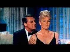 Theatrical trailer for the delightful romanti comedy, THAT TOUCH OF MINK (1962), starring Doris Day, Cary Grant, Gig Young and Audrey Meadows. Deftly directed by Oscar winner Delbert Mann, the film was a critical and commercial success, garnering three Oscar nominations and winning a Golden Globe for Bets Comedy Picture. It also marked the only ...