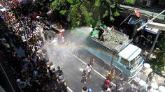 The act of pouring water (pictured during Songkran April 13-15) as a show of blessings and good wishes is the New Year's celebrations in some Southeast Asian countries (Thailand, Laos, Myanmar, and Cambodia) - http://www.backyardtravel.com/destinations
