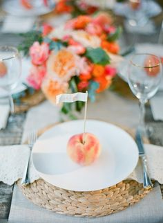 A peach used for the place setting accents perfectly into this colorful tablescape