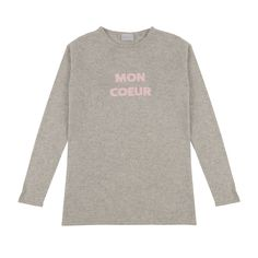 Mon Coeur Grey Cashmere Blend Sweater: Our cashmere Mon Coeur slogan sweater is a round neck, light grey fitted cashmere sweater, with an intarsia knit slogan 'Mon Coeur (meaning 'My Heart') in rose pink. The sweater is made from a cashmere and silk blend. Designed to be worn all season round, to be loved and to last a lifetime.