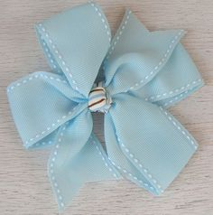 Little Girls Hair Bow, Blue Bow with a Blue and Brown center. Bow is adhered to a clip. $4.25 www.bellaandgracies.etsy.com