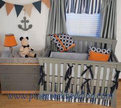 Navy and Grey crib bedding with orange in a nautical boy's nursery