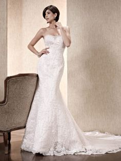 A stunning gown of lace and with a Swarovksi encrusted neckline by designer Kenneth Winston.    Come visit us and see our entire collection.  We are happy to assist you with selecting the perfect gown for you.   www.mylittlebridalboutique.com and www.mylittleflowershop.com  #mylittlebridalboutique #mylittleflowershop #weddingplanning #palmspringswedding #weddinggowns #weddingflowers #kennethwinston