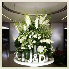 Love this look for a escort table!!! Place card table centerpiece. All white flowers.