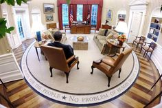 """Aug. 29, 2014 """"This view of the President reading briefing material was taken with a remote camera set up on the mantel above the fireplace in the Oval Office."""" (Official White House Photo by Pete Souza)"""