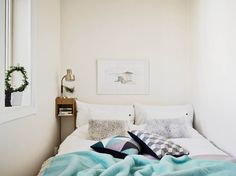 love this one. Love the pop of color with the aqua blanket and the simplicity of the rest. it all goes together and matches but not too much!