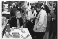 """ID#0241 Date: 1984-1989. This is a photo of Robert Fulgham signing his book All I Really Need to Know I Learned in Kindergarten. This reading and signing happened during his semester-long visit at the college. Participant: Liz Burgess. Additional Sources: Karen Long Interview 01/27/01; Oberlin Heritage Center: Fred Maddock files; McQueen, Albert, """"A Brief History of the Oberlin Consumers Cooperative and its Businesses.""""; Inge, Angela. """"A long Co-op History"""" Chronicle-Telegram, June 18, 2000."""