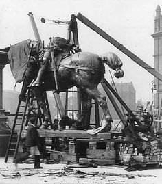 1903. View of the statue of the Black Prince under construction in Leeds City Square.