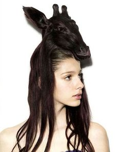 what the heck is that on your head?  hair sculpture.  oh, ok.