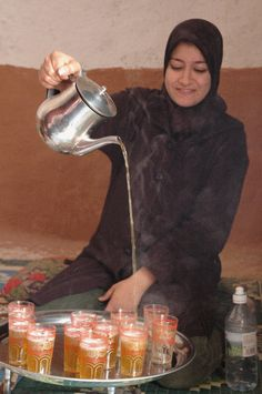Woman pouring Moroccan mint tea