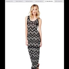Beautiful Tribal Print Maxi Dress NWOT This has never been worn. Dress is very flattering to the figure. Dresses Maxi