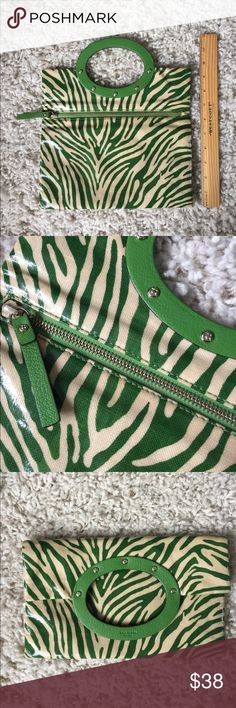 Kate Spade Green zebra print handbag Green zebra Kate Spade handbag only used a handful of times. I'm not 100% on what the material is; like printed fabric with laminate on it. Purchased from Kate Spade store in Boston. Can be worn on wrist or folded as a clutch. In great shape, a few small discolored spots but you have to look close up to see them. Inside is great shape, green with black dots. Great bag for summer! kate spade Bags Clutches & Wristlets