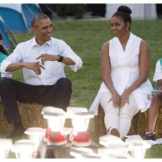 US President Barack Obama and First Lady Michelle Obama show off their dance moves as they visit with Girl Scouts that are camping overnight on the South Lawn of the White House in Washington, DC, June 30, 2015. Fifty Girl Scouts will spend the night on t