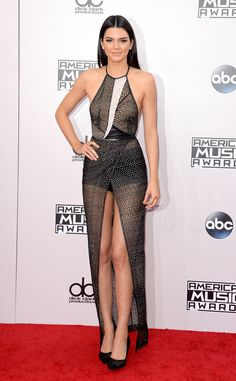 Kendall Jenner - 2014 AMAs Red Carpet Arrivals  Wowza! The model flaunted lots of skin in this ultra sheer Yigal Azrouël number.