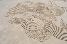 This is in sand, but how awesome would it be to draw this in wet cement?