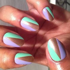 Sea foam green and lilac nails with triangles of gold.