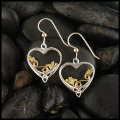 """""""Daisy's Heart"""" earrings; Sterling Silver frame with 18K Yellow Gold floral details. Available with Leverbacks. View matching pendant. View as a set. Item number: SW3287-Ivy Original designs © Stephen"""