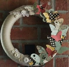 Styro wreath, string, buttons and paper.
