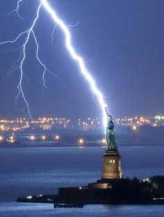Real shot of lightning that hit the  Statue of Liberty in New York, USA