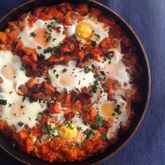 Sweet potato, chorizo and caramelised onion hash with baked eggs recipe at www.morethanjusttoast.com