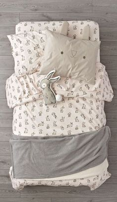 Organic Bunny Bedding. The light pink duvet cover and sheet set are adorned with printed rabbits for a playful touch. Add the unique bunny face sham and round out the look. #bestduvetcovers
