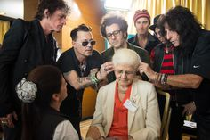 Alice Cooper Photos Photos - Joe Perry, Johnny Depp, Bruce Witkin, Robert DeLeo, Tommy Henriksen and Alice Cooper of the Hollywood Vampires install an hearing aid on a patient of the Starkey Hearing Foundation at Four Season Hotel Ritz Lisbon on May 27, 2016 in Lisbon, Portugal. - Starkey Hearing Foundation Hearing Mission With Hollywood Vampires - Rock in Rio Lisboa 2016