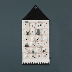 Ferm Living Christmas House Advent calendar will make all of December special with little suprises everyday for your children. Colour: Black/WhitePiping colour