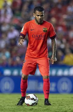 Dani Alves of Barcelona in action during the La Liga match between Levante UD and FC Barcelona at Ciutat de Valencia on September 21, 2014 in Valencia, Spain.