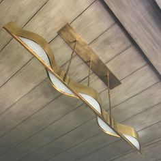 Love your curves. The Avant Linear Pendant is available in Brass Polished Nickel and Bronze.