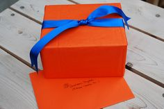 Orange Tissue Paper & Blue Satin Ribbon...Classic Complementary Color Pairing