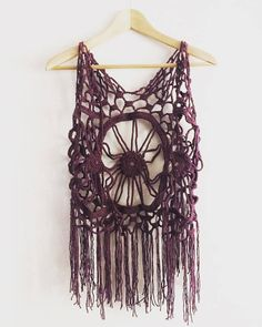 This purple crochet dreamcatcher or mandala vest was handmade thinking on free gipsy lifestyle. The mandala was made with no pattern, so if you want the design, just convo me. This vest is a size S to L, with no buttons in front, to wear free and fluid. You can order other color, it