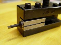 """This ⅜"""" round to ½"""" square, slit, steel adapter eliminates setscrew marring on the shaft."""