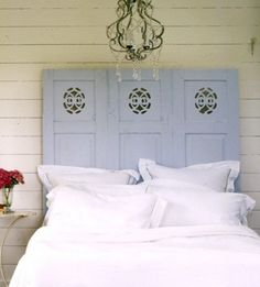Vintage shutters as headboard