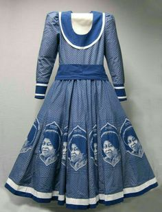 Da Gama Traditional Dresses, A tailored woman's dress with open neck, long sleeves, sash/belt and flared skirt made out of indigo dyed