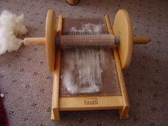 """A Louet roller-style """"blending board,"""" or carding board. A Louet roller-style """"blending board,"""" or carding board. Always wanted to learn how to knit, but unsure where to s. Diy Spinning Wheel, Spinning Wool, Hand Spinning, Spool Crafts, Yarn Crafts, Loom Weaving, Tapestry Weaving, Peg Loom, Native Beadwork"""