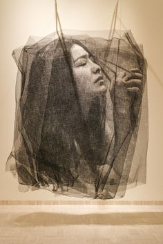 Seung Mo Park, small meticulously snipped & wrapped pieces of screen door-like material attached together to create a hanging portrait