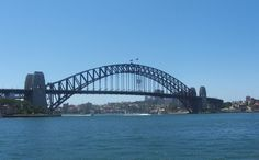 The Sydney Harbour Bridge was designed by John Bradfield and built by Dorman Long, an English company.